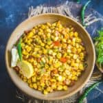 Corn Chaat is a mix of boiled corn kernels which is tossed with chutneys, veggies and a tad of spices which renders it a superb flavour. You can also call it sweet corn chaat masala if you wish to :) Here is how to make corn chaat at home in 2 different ways.