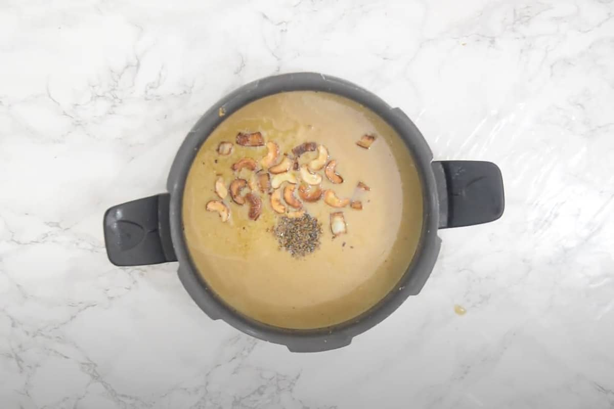 Nuts with ghee and cardamom powder poured in the payasam