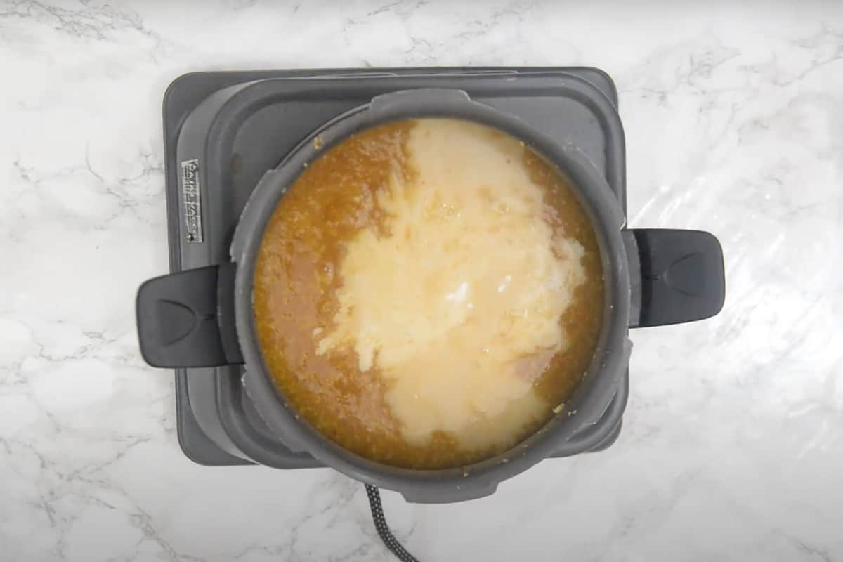 Thin coconut milk added in the cooker.