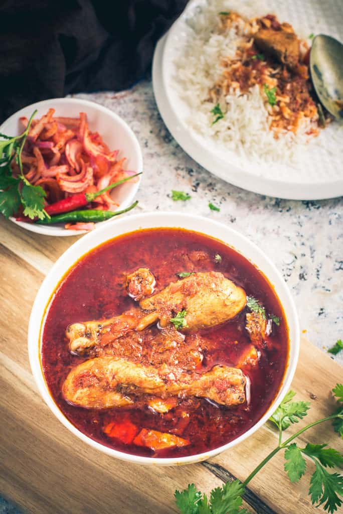 Tomato Chicken Curry is a delicious Chicken curry recipe which goes very well with roti or rice. It has a slightly tangy flavour from tomatoes.