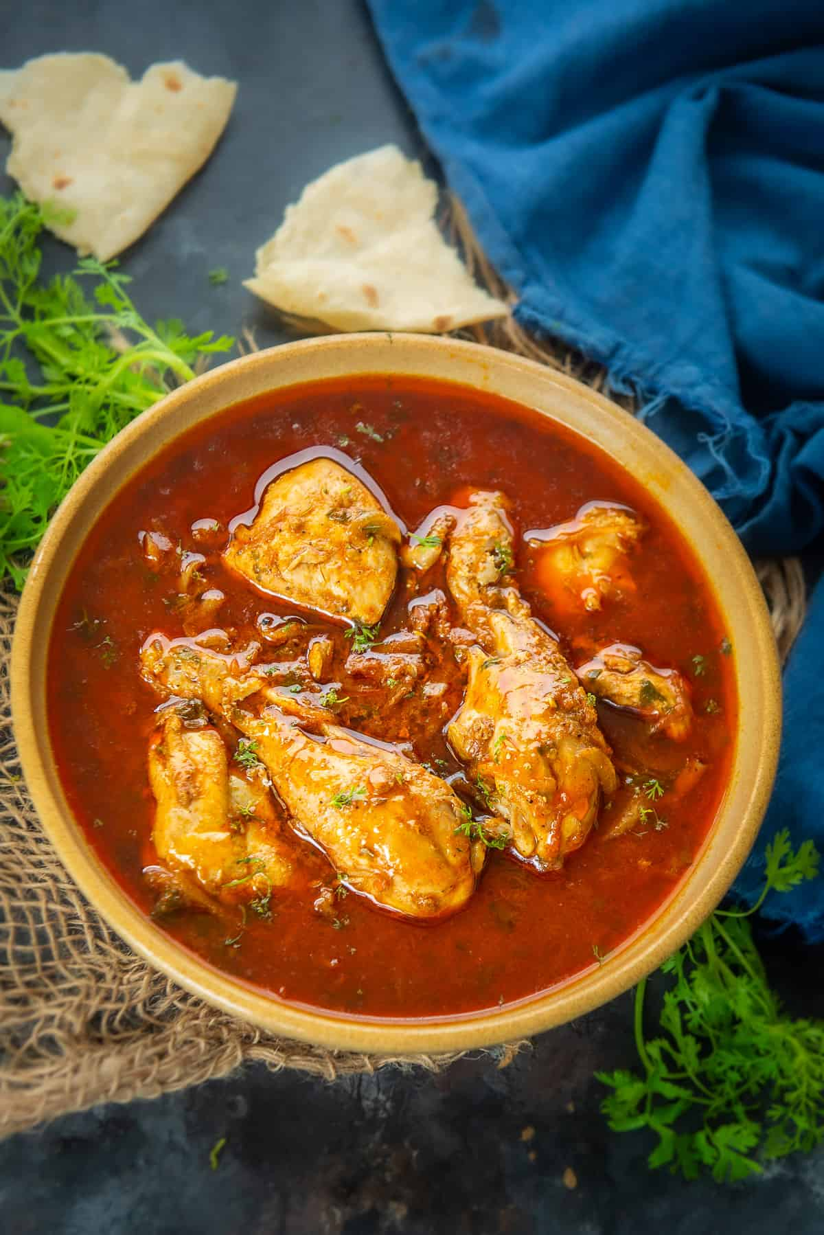 Tomato Chicken Curry served in a bowl.