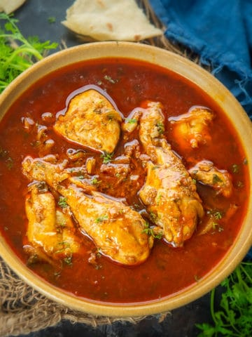 Tomato Chicken Curry is a delicious chicken curry recipe that goes very well with roti or rice. It has a slightly tangy flavor from tomatoes.