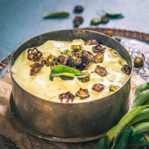 Served for Onam Sadya, Vendakkai Pachadi is more of a lady's finger raita that has a blend of coconut and tempering as well.