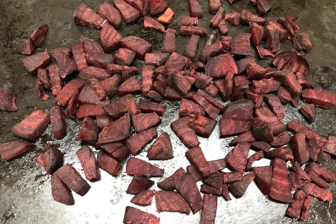 Roasted beetroot on a baking tray.