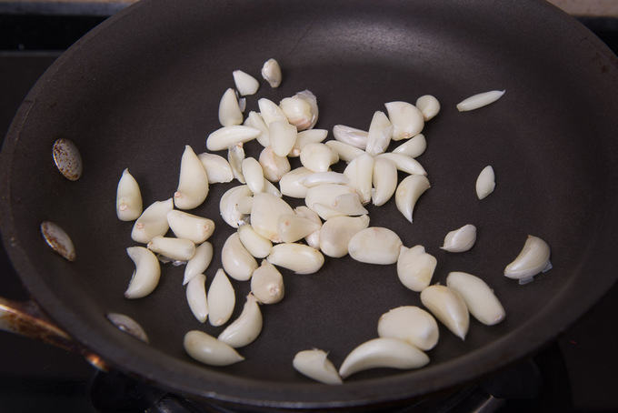Garlic roasting in a pan.