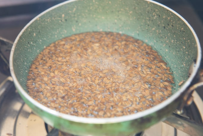 Cumin seeds and hing added in hot ghee.