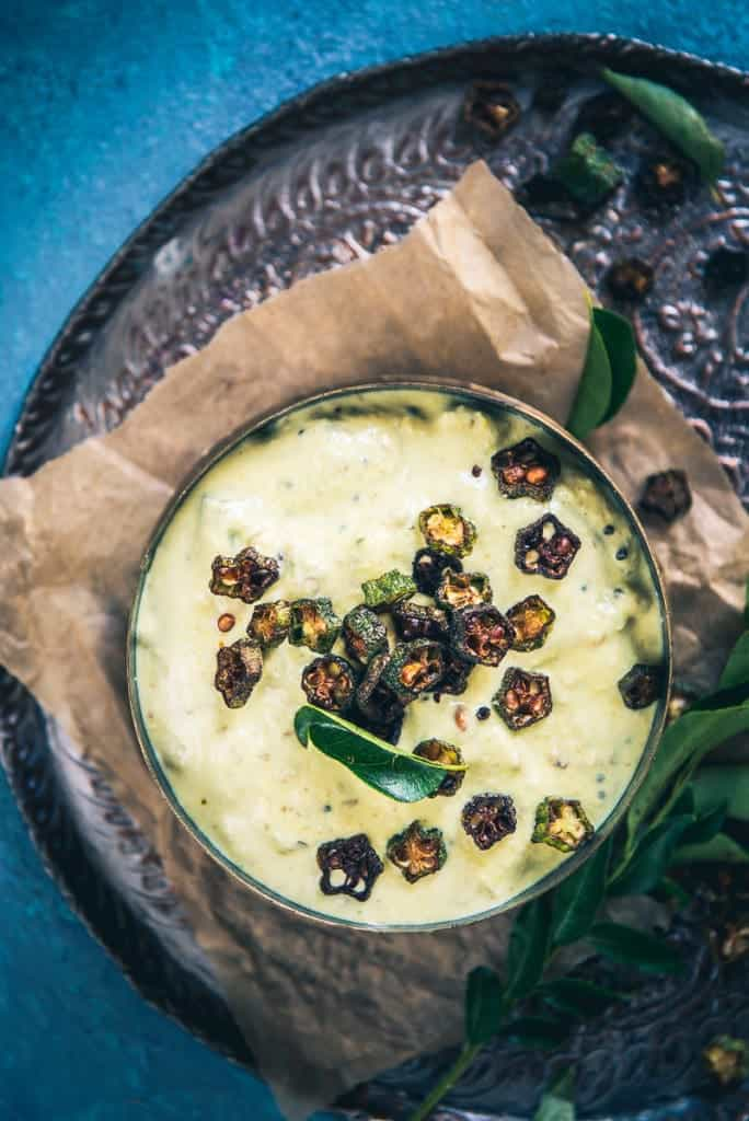 Served for Onam Sadya, Vendakka Pachadi is more of a ladies finger raita that has a blend of coconut and tempering as well.