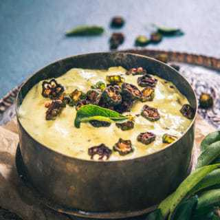 Served for Onam Sadya, Vendakkai Pachadi is more of a ladies finger raita that has a blend of coconut and tempering as well.