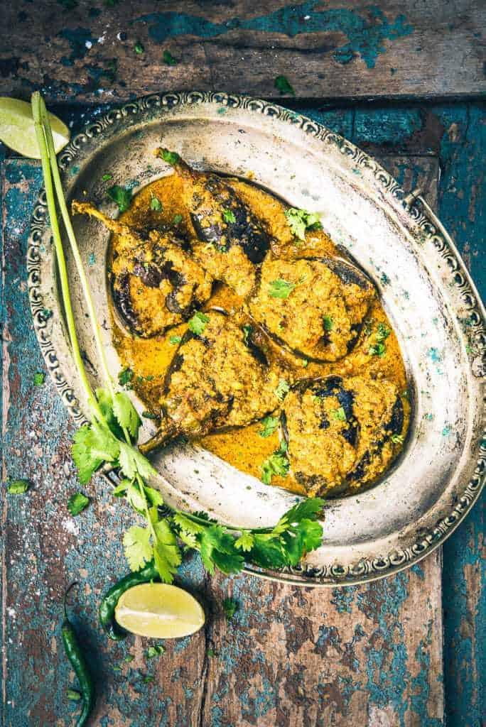 Bharli vangi recipe maharashtrian style stuffed brinjal whiskaffair the soft texture of stuffed brinjal marinated in spices and herbs in this maharashtrian bharli vangi forumfinder Image collections
