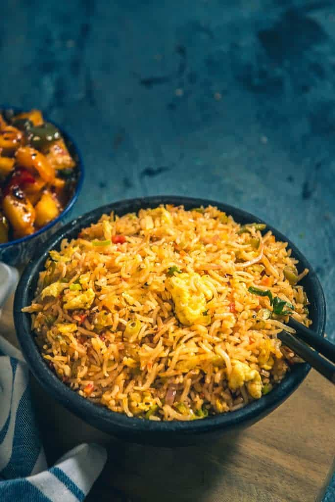 Spicy Indo Chinese Schezwan Egg Fried Rice Recipe is a delicious Chinese style spicy rice preparation which is very easy to make at home.