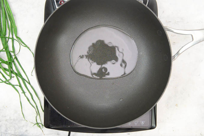 Oil heating in a pan.