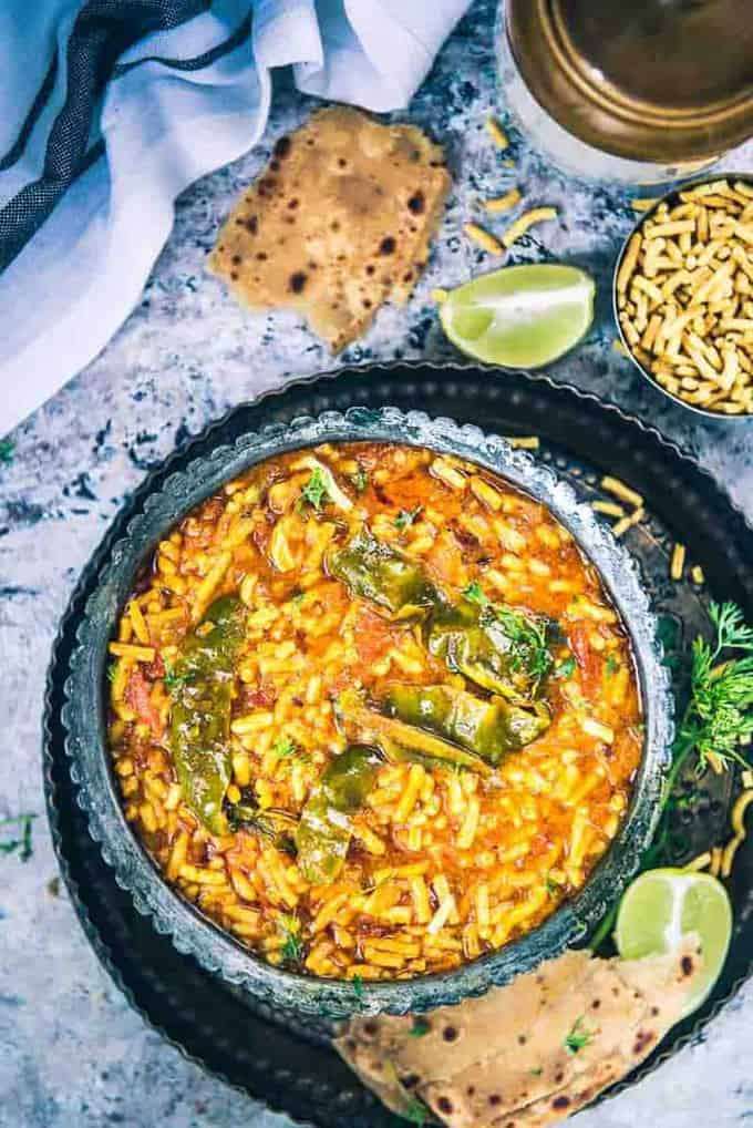 An incredibly humble accompaniment, Rajasthani Sev Tamatar Ki Sabji is made using juicy tomatoes, desi masalas and served with heaps of besan sev.