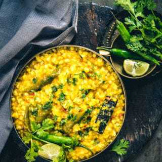 A typical, one pot meal, Jau Moong Dal Khichdi is made with wholesome ingredients like pearl barley, dhule moong dal which is finely mixed with spices.