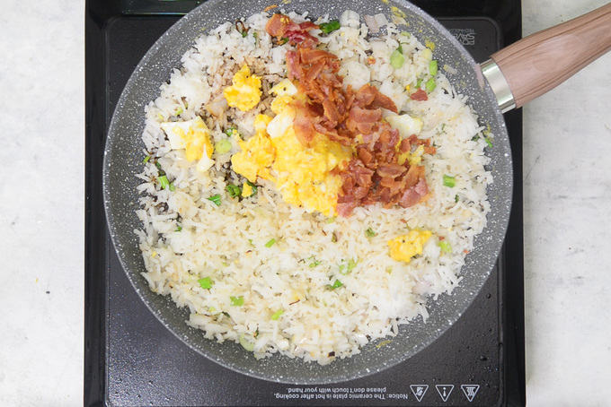 Soy sauce, rice, vinegar, egg and bacon added in the rice.