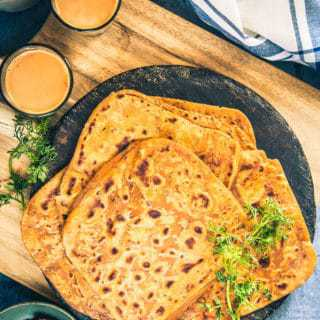 Chatpata Paratha Recipe is a lip-smacking Indian flatbread prepared by using a delicious combination of flour and tangy spices.