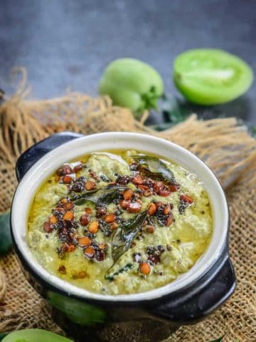 Green tomato chutney served in a bowl.