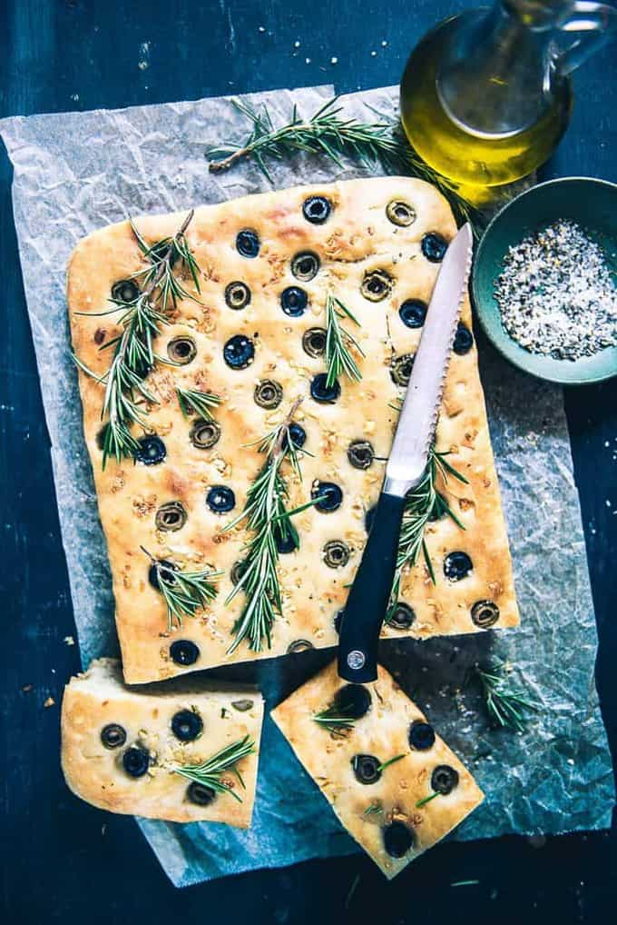 Focaccia is a flat bread made using yeast and olive oil. Olives Garlic Focaccia Bread Recipe gives you one of the most delicious Focaccia.
