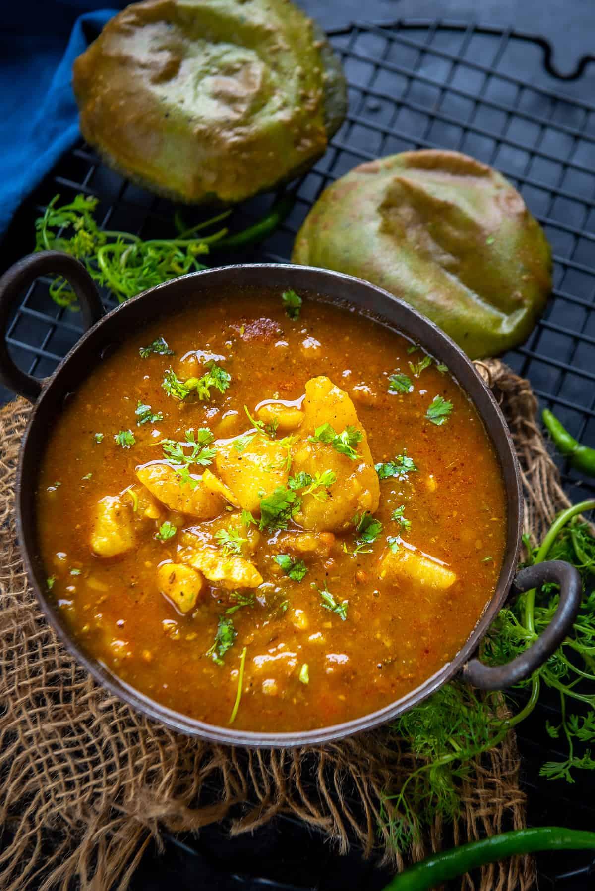 Bhandare wale aloo ki sabji served in a bowl.