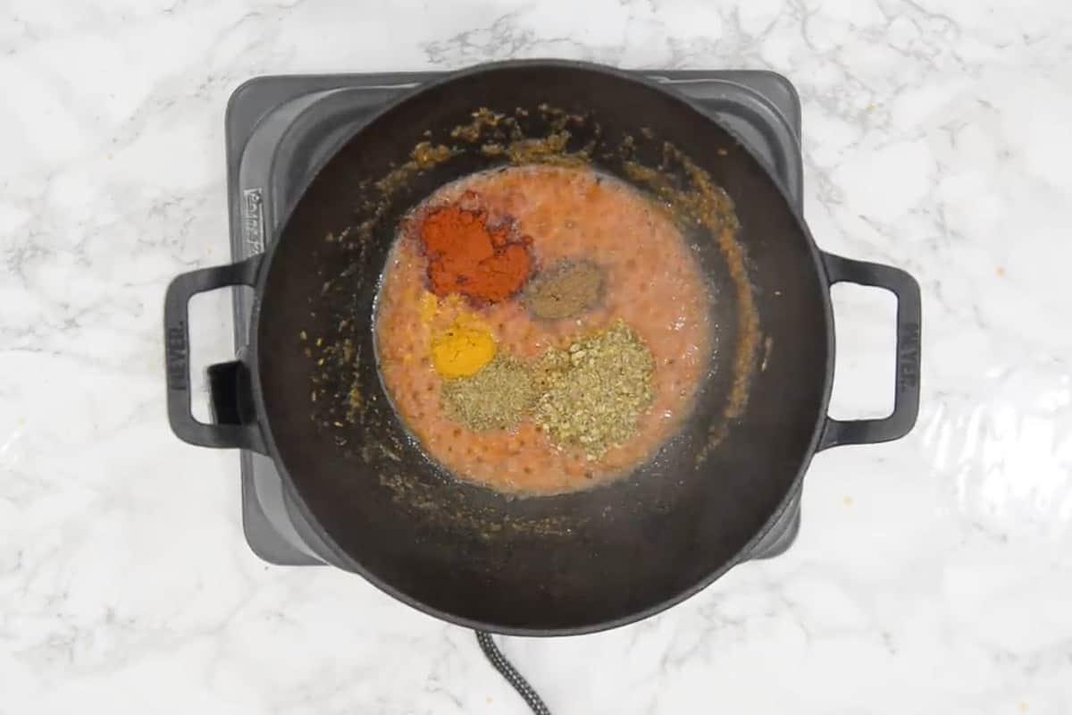 Coriander powder, fennel powder, turmeric powder, Kashmiri red chilli powder and garam masala powder added in the pan.
