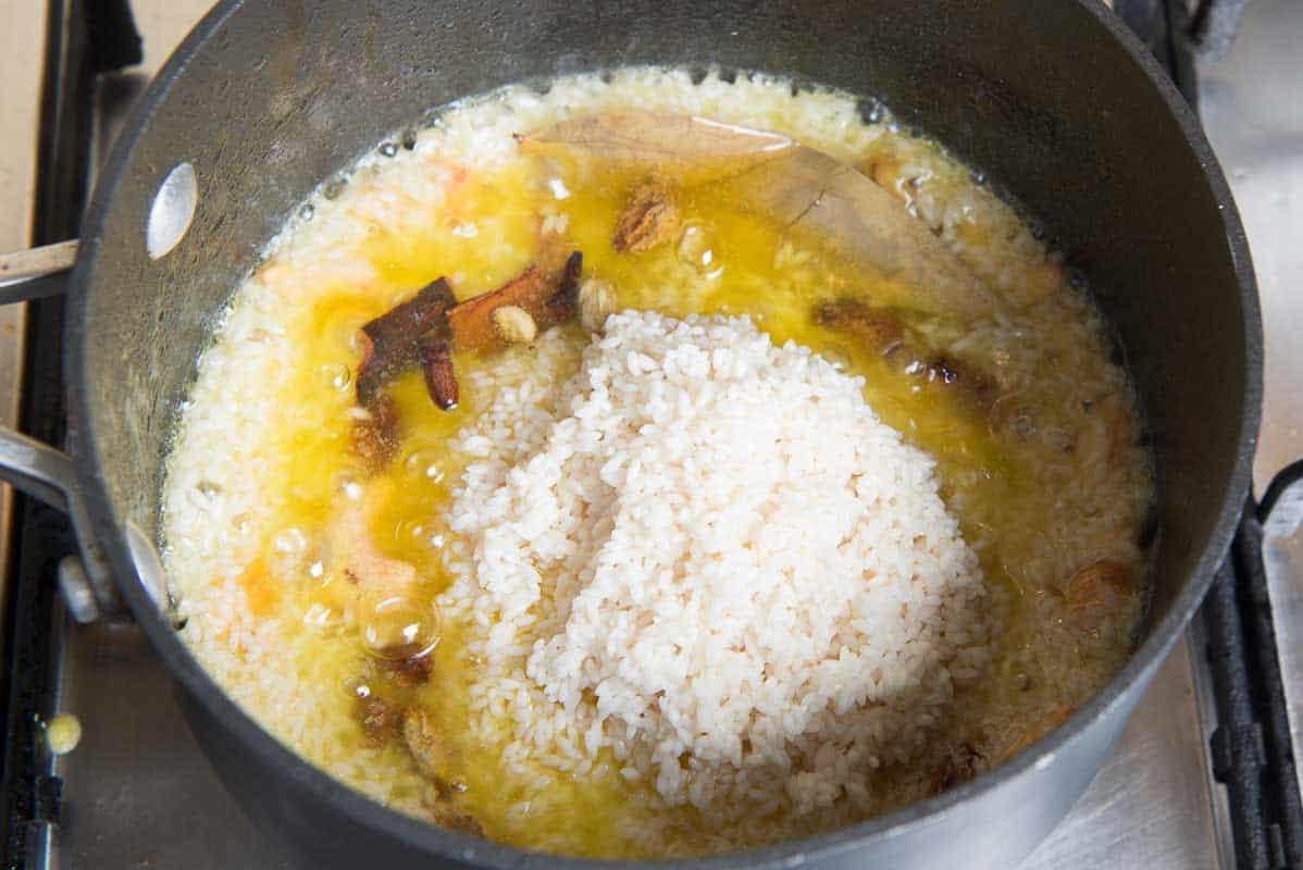 Bengali Mishti Pulao, Bengali Sweet Pulao, bengali basanti pulao recipe, yellow pulao recipe sanjeev kapoor, basanti pulao recipe video, polao ranna