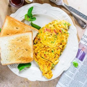 Masala Omelette is a super quick egg recipe which can be whipped in no time and makes for a lovely breakfast.