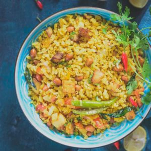 Red Rice Kanda Poha, Red Rice Poha Recipe or Red Poha Upma is a healthy and delicious breakfast option made using red poha and is very easy to make as well.