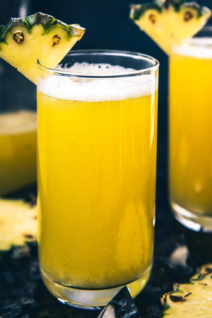 close up view of pineapple juice served in glasses