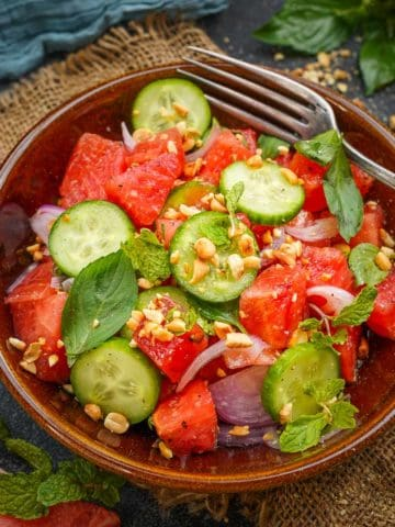 Thai Watermelon Salad is a healthy and refreshing salad loaded with Thai flavors. Make it in under 10 minutes using simple ingredients.