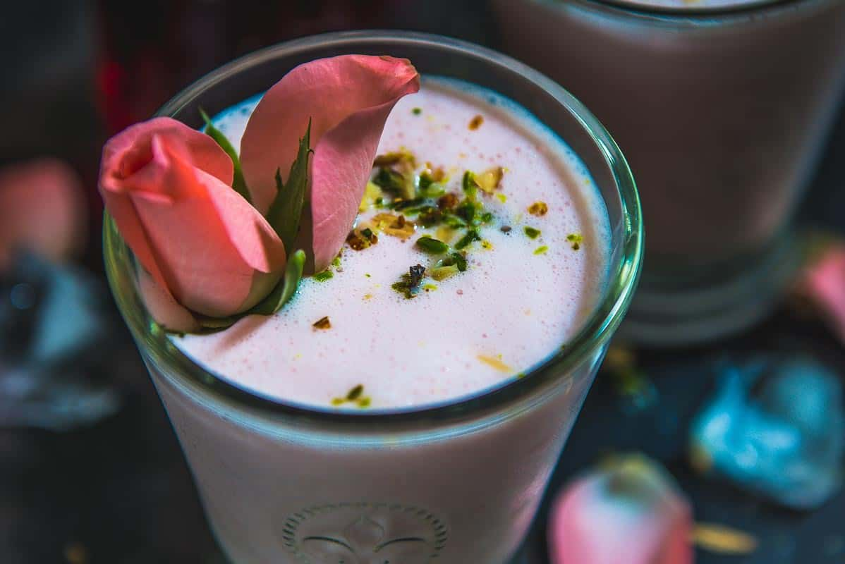 Rose lassi is delicious rose favoured yogurt drink which is perfect to beat the heat during summers. Make this 5 minute recipe and fall in love with this drink