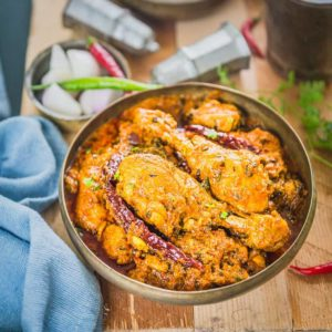 Out of the many Indian Chicken Recipes, this Dhaba Style Chicken Curry Recipe is one of our favourite. Juicy morsels of chicken simmered in a smoky onion tomato gravy is perfect to pair with some tandoori roti or Jeera Rice.