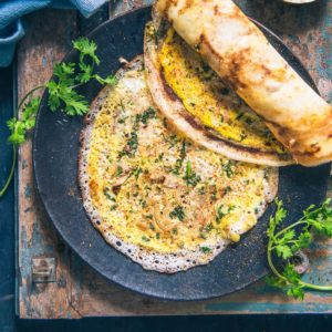 Egg Dosa Recipe, How to make Egg Dosa (Mutta Dosa) Step By Step Recipe. This recipe is perfect for a healthy breakfast option and is super easy to make. Pair it with a spicy chutney for a wholesome breakfast.