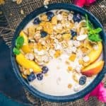 Peach Oat Smoothie Bowl or Peachy Oat Smoothie is a delicious Peach Smoothie Recipe which is a breeze to make and is quite filling to sail you till the lunch time.