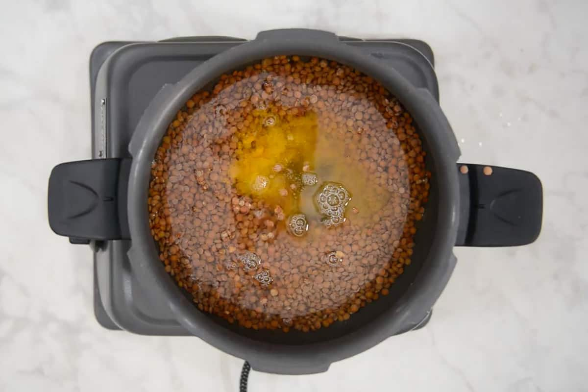 masoor dal added in a pressure cooker along with salt, turmeric powder and water.