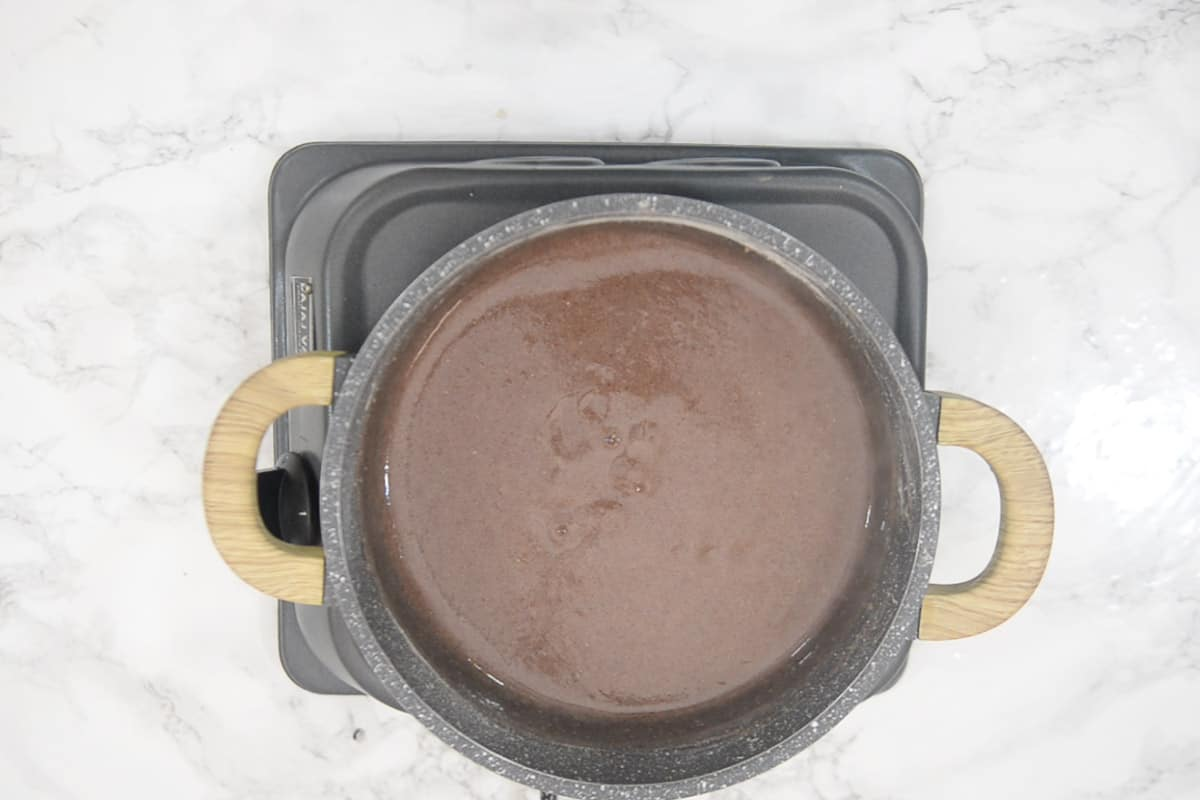 Water added in the pan and a smooth mixture made.