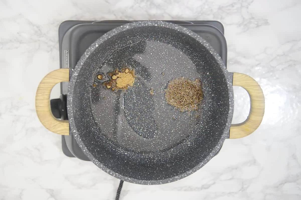 Cumin seeds and hing added in hot oil.