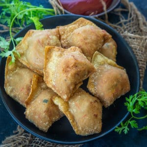 Crab Rangoon is a very famous Chinese snack made with a cream cheese and crab meat filling filled inside wonton wrappers and then deep fried. Here is how to make these.