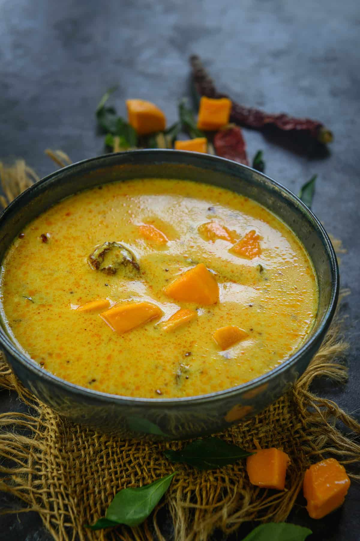 Fajeto or mango kadhi served in a bowl.