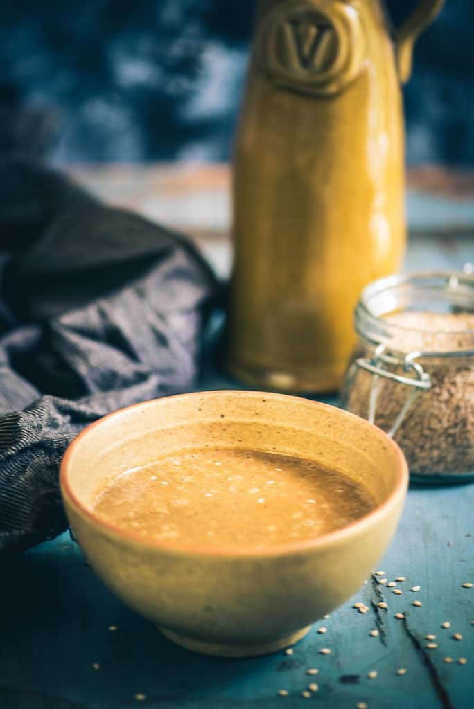 Step by Step and video Easy Homemade Tahini Paste Recipe or How to make Tahini at home with just 2 ingredients and ideas to use it.