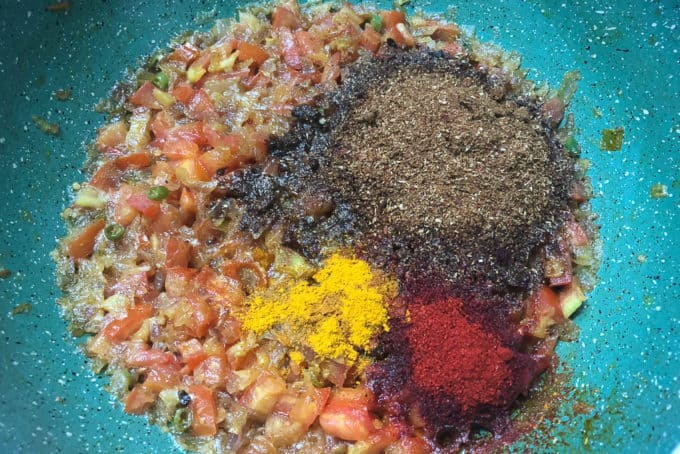 Chole masala, turmeric powder and red chilli powder added in the pan.