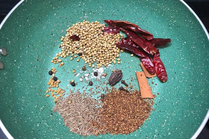 Chole masala ingredients in a pan.