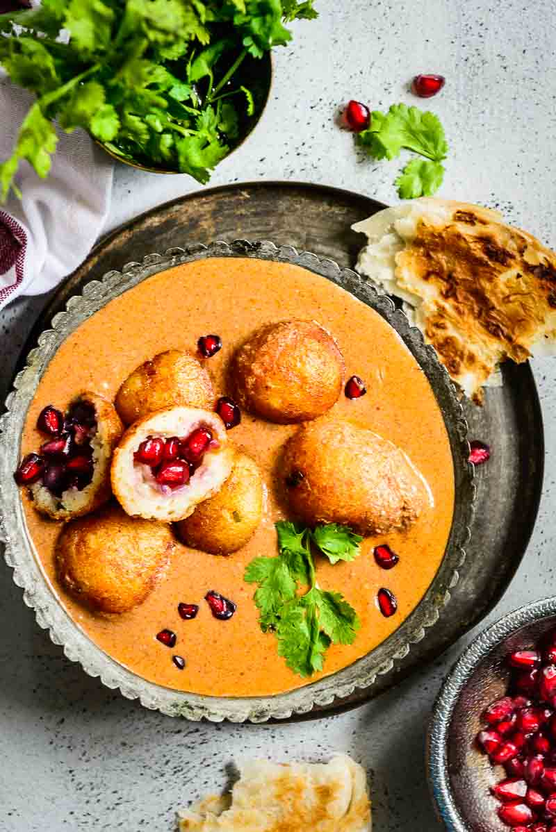 Anari Paneer Kofta has a signature taste of pomegranate seeds rolled as balls with paneer, khoya, spices,potatoes which are served in a toothsome gravy. Here is a simple recipe to make it.