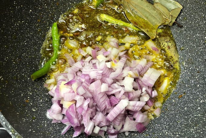 Onions added in the pan.