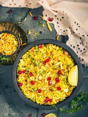 Indori Poha is a style of making Poha or flattened rice like how it's made in Indore. Here is How to make Indori Poha.