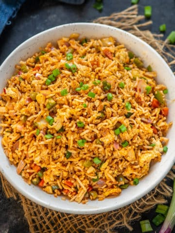 Spicy Indo Chinese Schezwan Egg Fried Rice is a delicious Chinese style spicy rice preparation which is very easy to make at home. Here is how to make it.