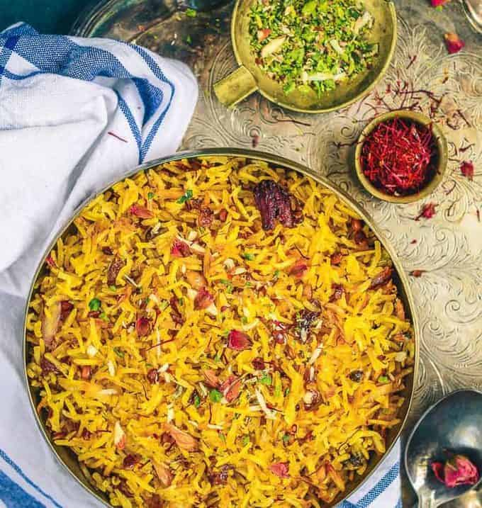 Zafrani Pulao or Sweet Saffron Pulao is a delicacy made using rice, saffron, sugar and dry fruits and is served especially during festival time.