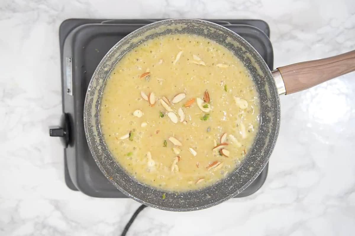 Dry fruit added in cooked aloo ka halwa.