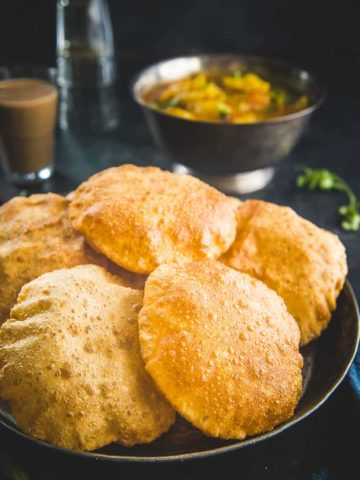Bedmi Poori served in a plate.