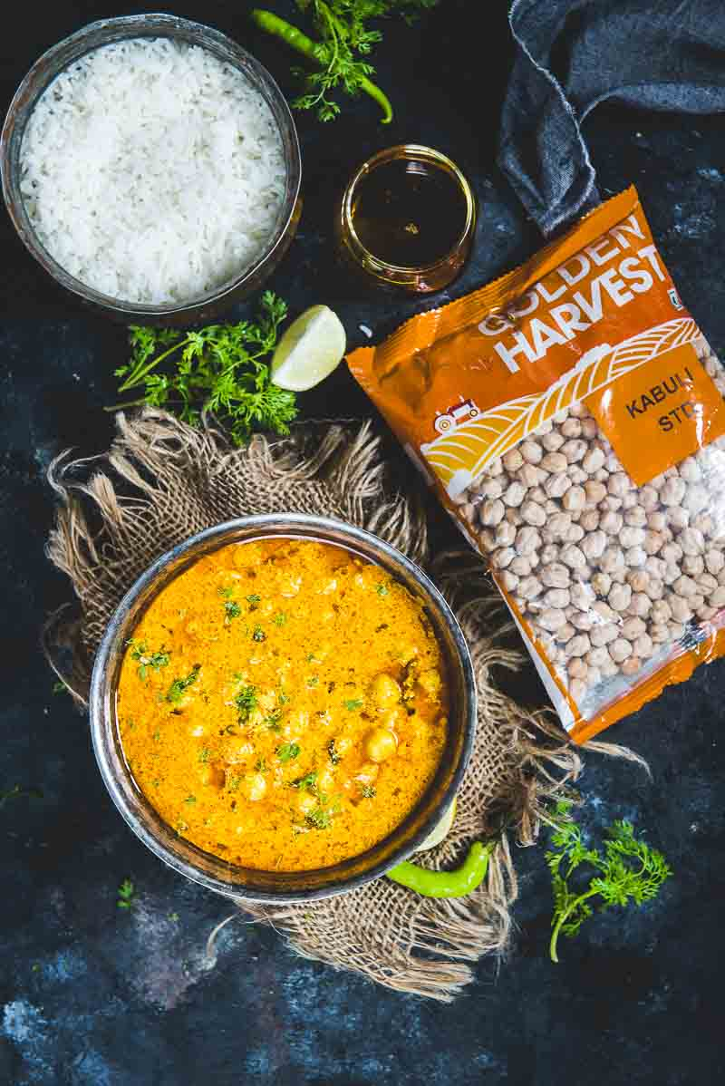 Top view of chana Madra served in a bowl along with a packet of golden harvest kabuli chana.