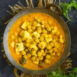 Chana Madra is a Himanchali style curry where Chickpeas are cooked in a yogurt Sauce along with spices. Serve it with steamed rice for a perfect meal.