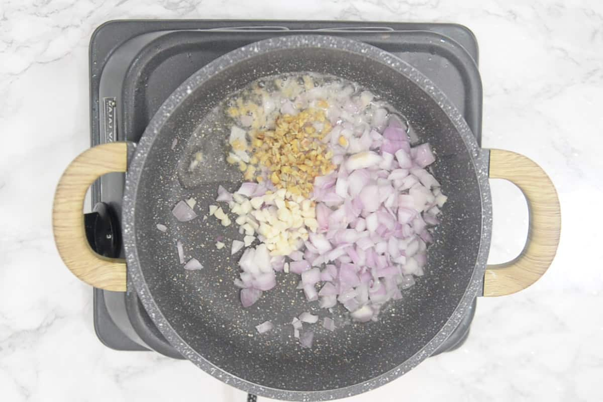 Onion, ginger and garlic added in the wok.